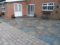 Transform your patio with this beautiful copper slate paving and peak stone blocks.