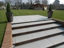 granite paving to steps and patio leading on to newly laid lawn