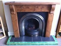 5x10 handmade ceramic tiles with brass edging trim and feature strip surrounding black porcelain tiles on fire hearth
