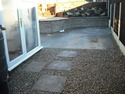 3 Level Garden Build at Bolton. After. Scottish pebbles with stepping stones leading onto Level 1 Concrete paving.