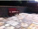Retaining walls and natural sandstone paving enhanced the usable garden space.