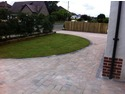 Tegula block pavoirs,semi circular feature lawn,dividing slatted fence.