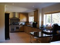 Extension to house in Hindhead Surrey allowed this beautiful 8m oak kitchen to be formed.
