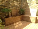 Bespoke Ipe decking, garden lighting, garden heather, under bench storage, bespoke mirror in Hammersmith