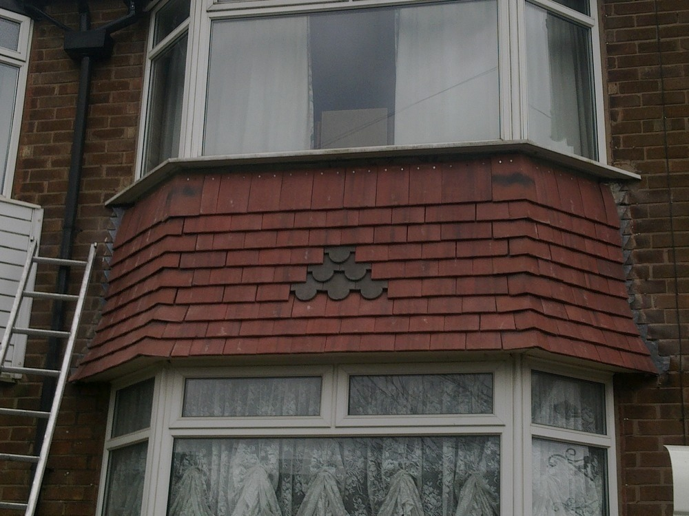 Replace Render With Tiles To The Bay Window Area Roofing