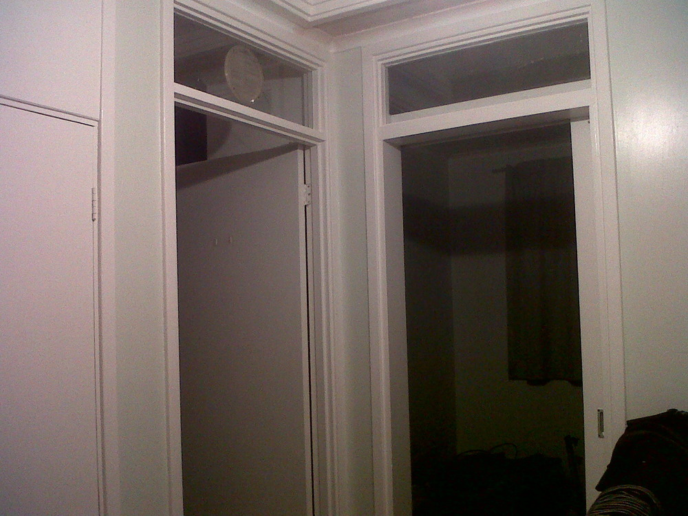 Remove Glass Panels Above Doors And Fill In Carpentry