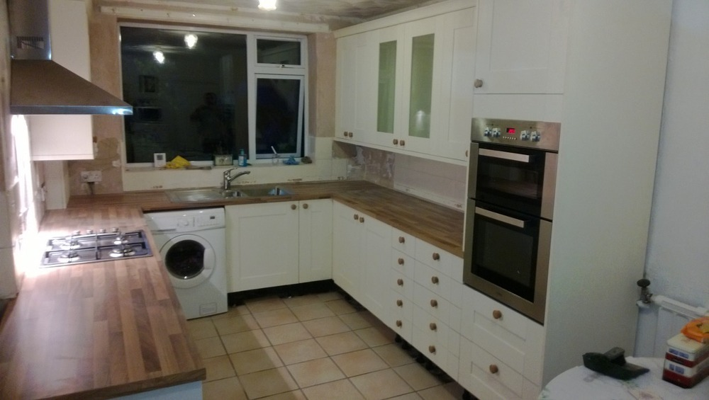new kitchen fitted ready for customer to fit own wall and floor tiles