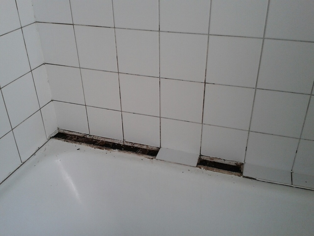Bathroom tiles and potential wood support of bath for Bathroom builders birmingham