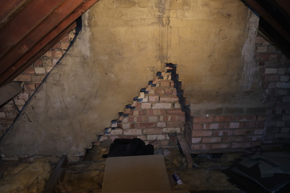 Fitting Gallows Brackets To Support Chimney Restoration