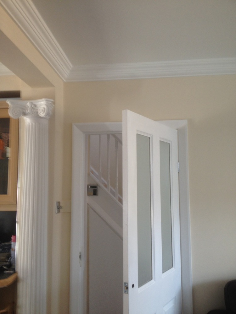 painted in white eggshell and the wooden door painted in white gloss