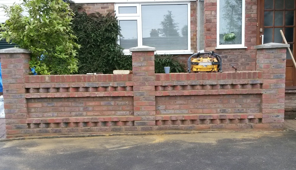 Garden wall, built to customers design with dog toothing detail ...