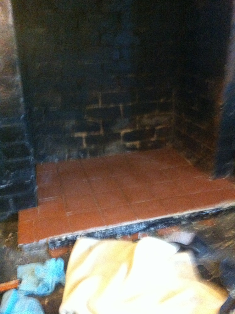 cleaning soot off old brick fireplace and repointing