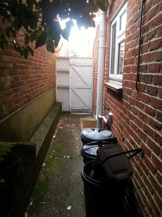 Side Extension Of Alleyway Into A Utility Room