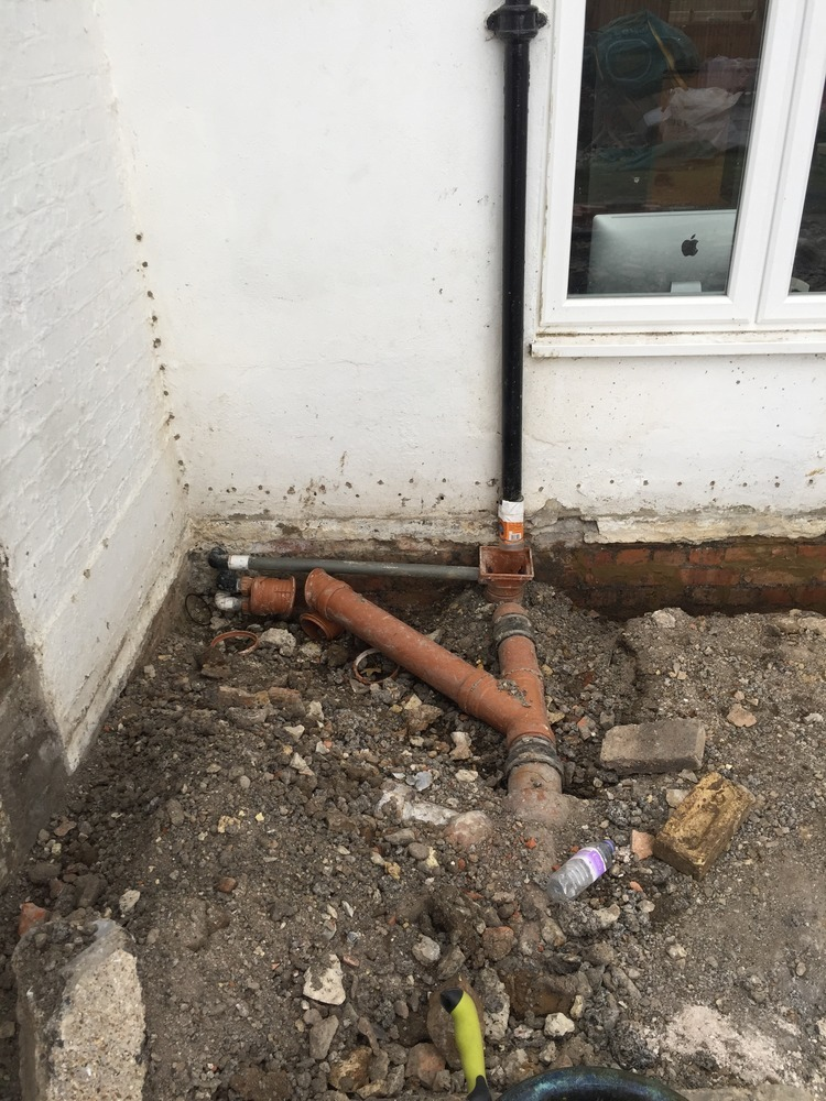 Rerouting Gutters And Drains Tidying Up Plumbing Job