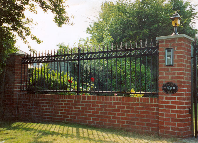 Erect Brick Wall With Wrought Iron Fencing Bricklaying