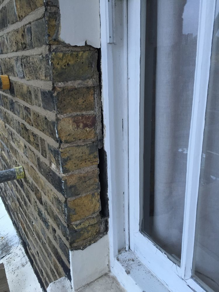 Parapet Wall Repair Rendering Around 2 Window Frames