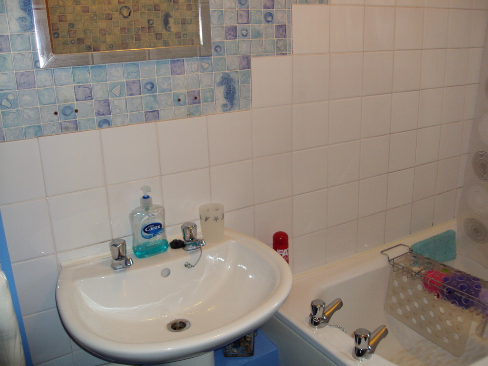 Bathroom retiled around bath and sink area tiling job in for Tiling around a bath