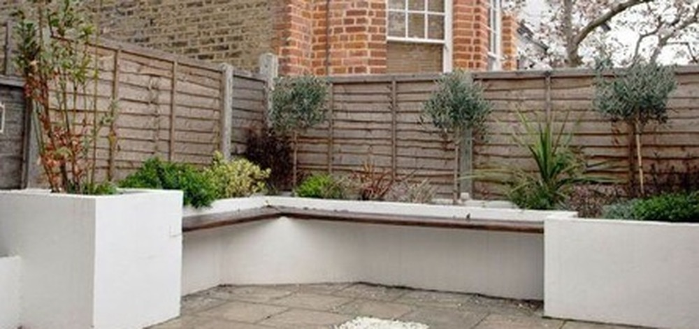 Garden decking with built in seating and planter bed for Garden decking north london