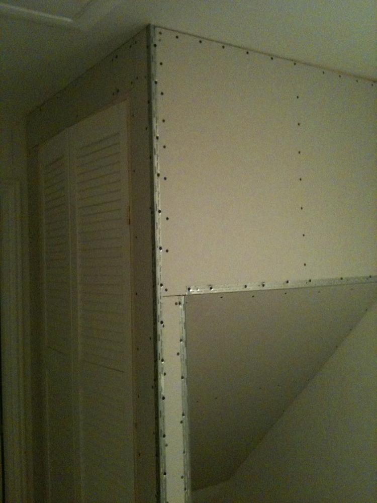 Taping And Skim Coat To New Cupboard Above Stairs