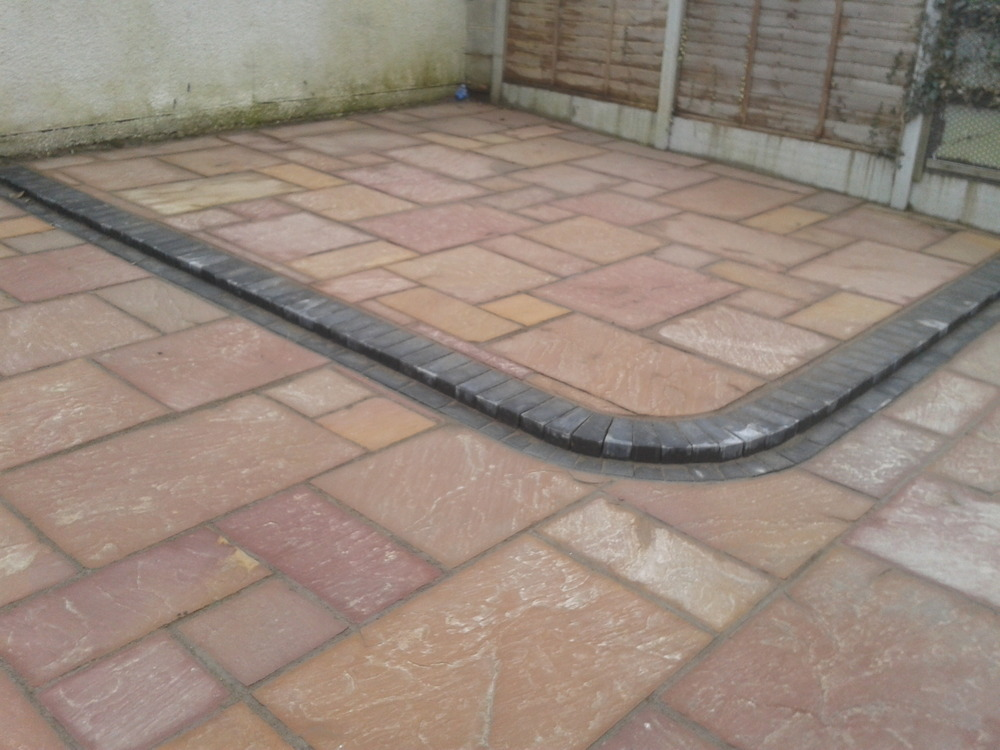 Indian Sandstone Paving With Retaining Wall Roll Out Turf Grass Bark