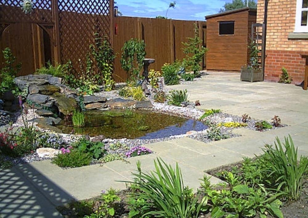 Caledonia paving landscape ltd 100 feedback driveway for Garden pond edging stones