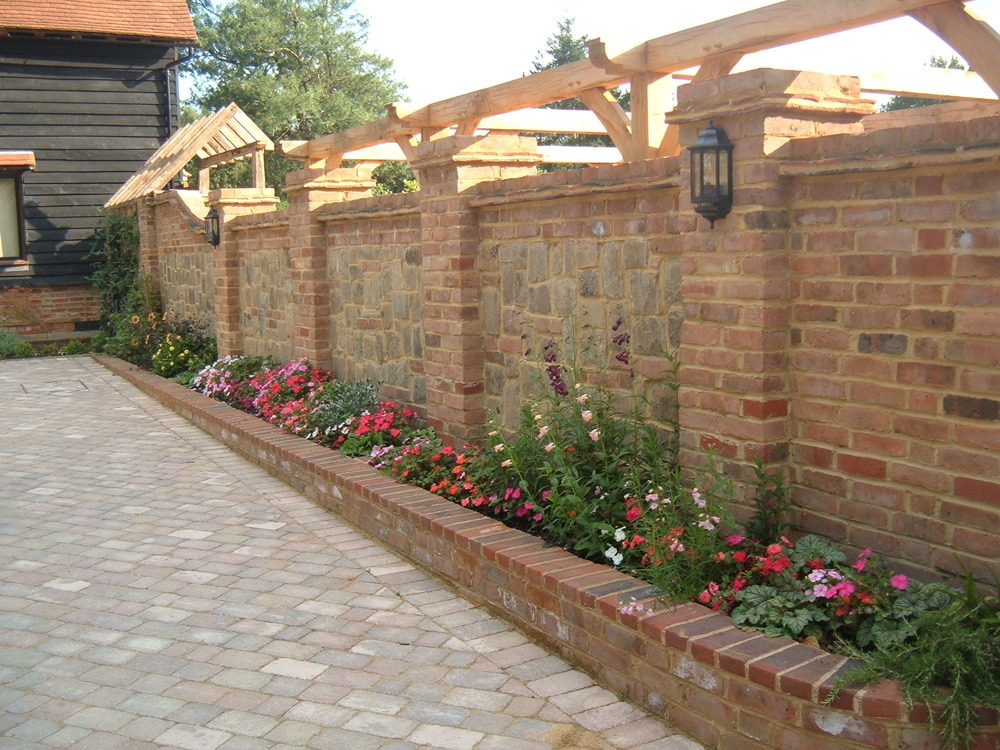Dougcusdenlandscapes 100 feedback landscape gardener in for Red brick garden