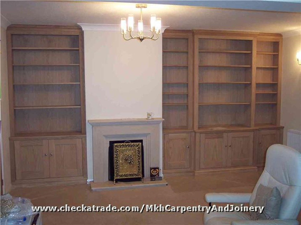 Cabinet shelves built either side of a chimney breast for Bathroom builders liverpool