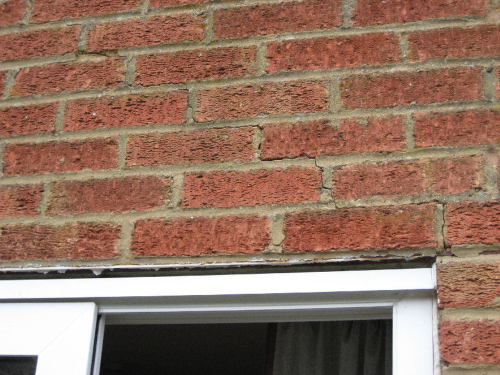 Repointing Cracks Above Patio Door Lintel Bricklaying