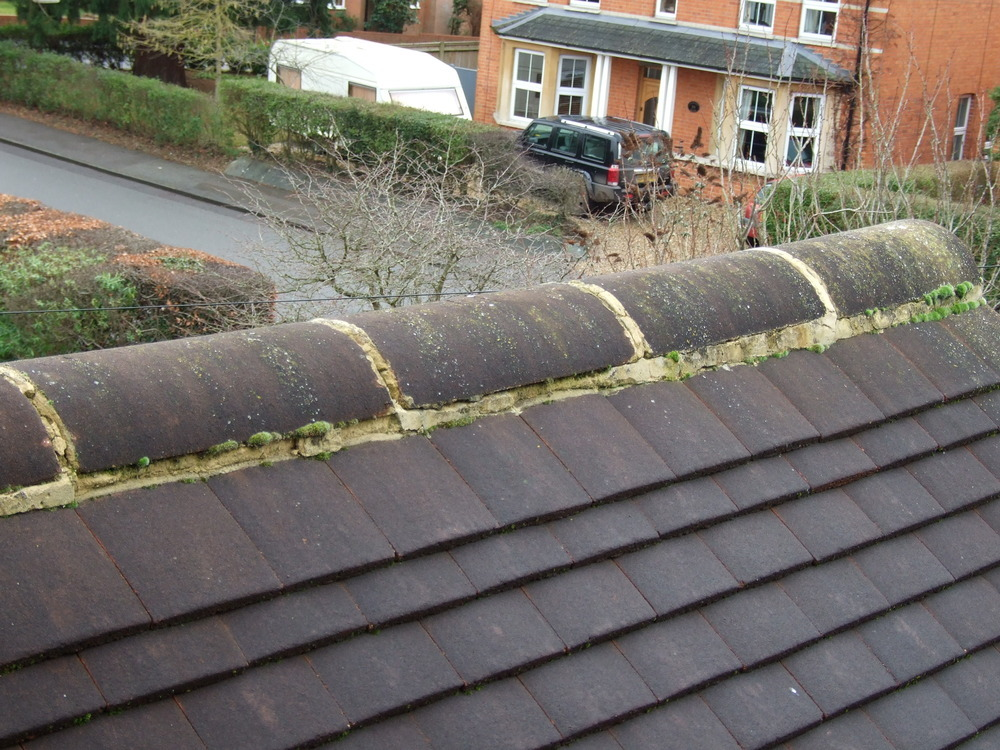 Reseat And Replace Mortar Under Ridge Tiles Roofing