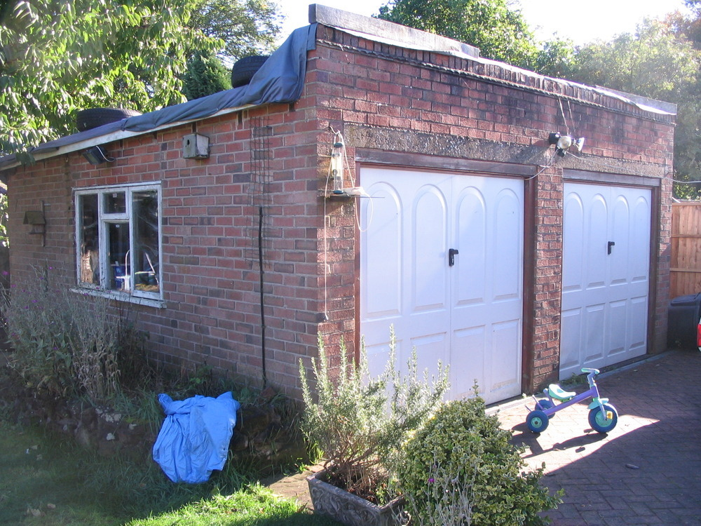Replace Flat Roof With Pitched Over Detached Garage