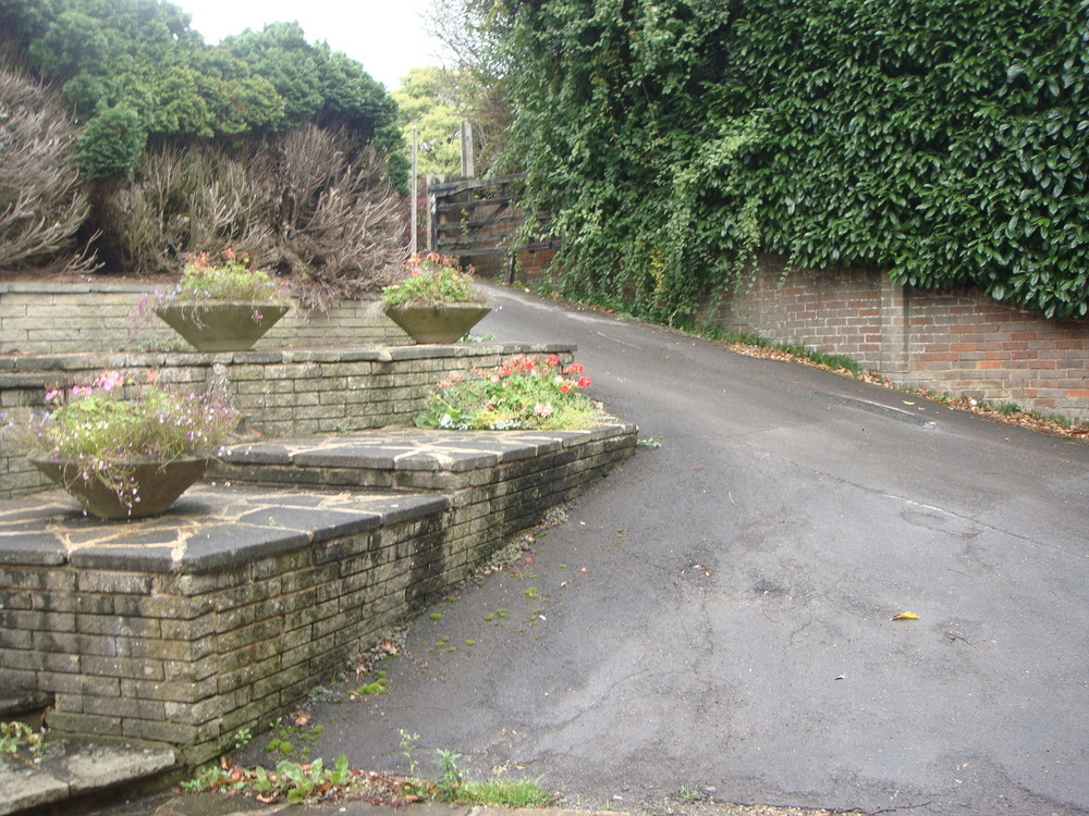 Design a solution for a steep driveway and build it for Sloped driveway options