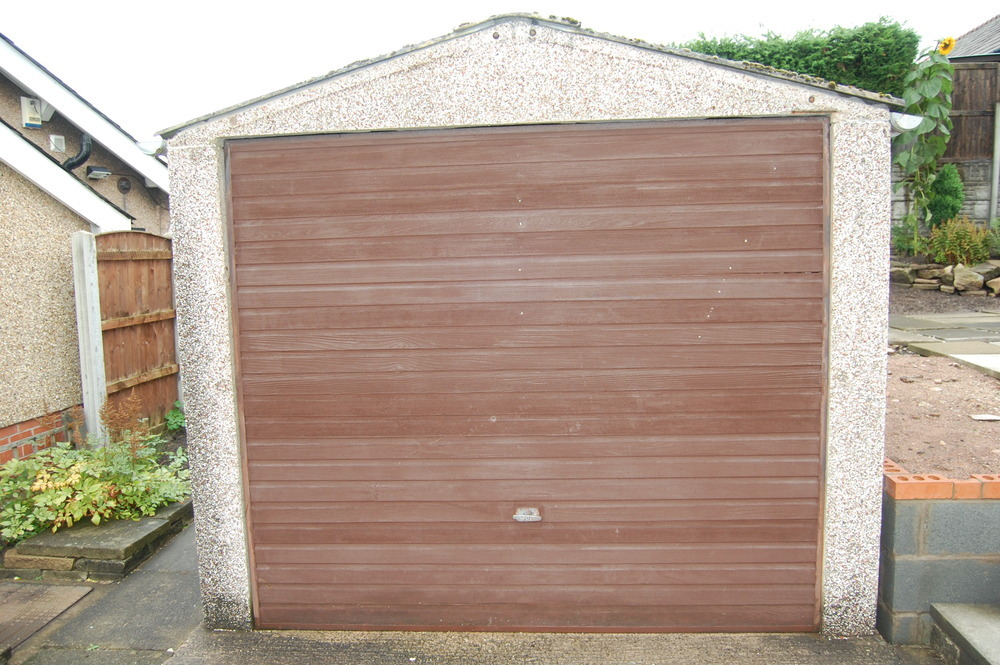 Replace Garage Door And Cladding On Concrete Garage