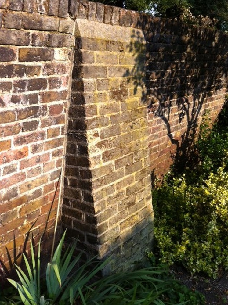 build a concrete    brick buttress to support wall