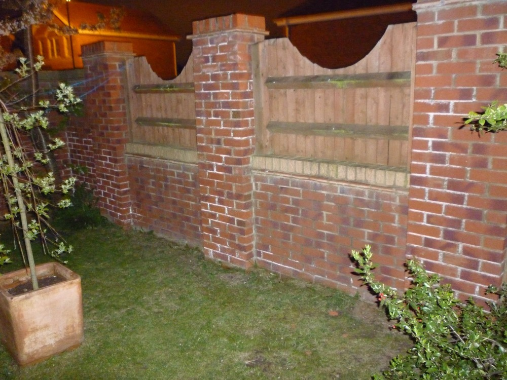 Moving 2m high brick garden wall approximatly back for Back garden wall designs