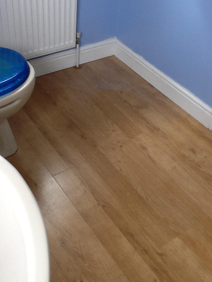 Vinyl floor fitted to small bathroom flooring job in for Flooring jobs