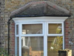 Re Tiling Of Bay Window Roof And Replacing Gutter