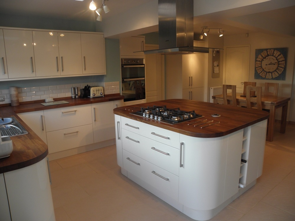 high gloss cream kitchen with solid oak worktops we installed in